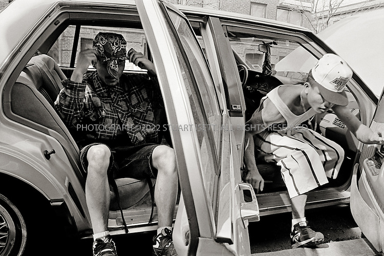 7/1993--Chicago, USA..OLB gang leader Ricky (left) and Bobby arrive a an OLB party at Gino's family apartment...All photographs ©2007 Stuart Isett.All rights reserved.This image may not be reproduced without expressed written permission from Stuart Isett.