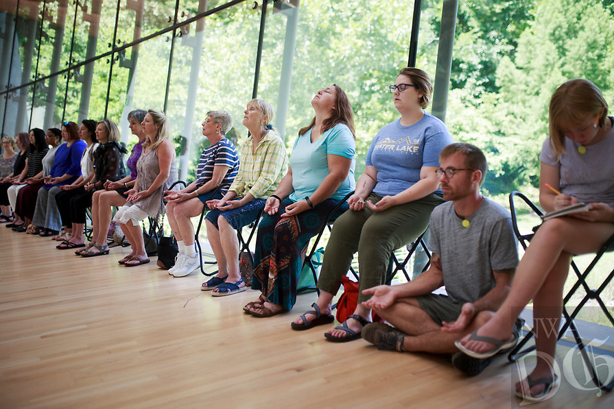 NWA Democrat-Gazette/CHARLIE KAIJO Attendees meditate during an art meditation event, Monday, August 6, 2018 at Crystal Bridges in Bentonville. <br />