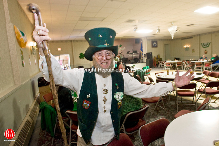 WATERBURY, CT - 17 MARCH 2010 -031710JT01-<br /> John Guertin, 76, poses with his new leprechaun hat, which was handmade in County Cork, to replace a hat that he had worn for decades on St. Patrick's Day and was decorated with pins given to him over the years. Here Guertin visits the Elks Lodge in Waterbury, one of several establishments he visits annually on the holiday.<br /> Josalee Thrift Republican-American