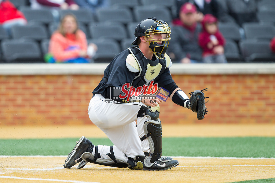 Wake Forest Demon Deacons catcher Ben Breazeale (9) fields a throw at home plate during the game against the Florida State Seminoles at Wake Forest Baseball Park on April 19, 2014 in Winston-Salem, North Carolina.  The Seminoles defeated the Demon Deacons 4-3 in 13 innings.  (Brian Westerholt/Sports On Film)