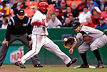18 May 2007: Washington Nationals shortstop Cristian Guzman gets back to first safely as first baseman Kevin Millar catches the pick-off attempt during a game against the Baltimore Orioles at RFK Stadium in Washington, DC. The Orioles defeated the Nationals 5-4 in the first game of the 3-game interleague series...Mandatory Photo Credit: Ed Wolfstein Photo
