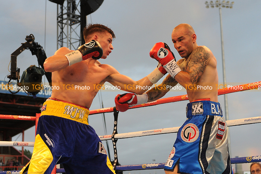Martin J Ward (blue and yellow shorts) defeats Sergio Blanco on points during a Boxing show at Craven Park Stadium, Hull, United Kingdom, promoted by Matchroom Sports on 01/08/2015
