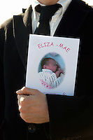 Tuesday 11 March 2014<br /> Pictured: A man clutching the order of sevice <br /> Re: A funeral has taken place  in Pontyberem Catholic Church for six day old Eliza-Mae Mullane who died after an incident at the family home in Carmarthenshire in the morning of 18 February 2014, where police later seized two dogs, an Alaskan Malamute called Nisha and a collie cross that were destroyed following the baby girl's death.<br /> Parents Sharon John and Patrick Mullane said previously that they would cherish the short time they had with her.
