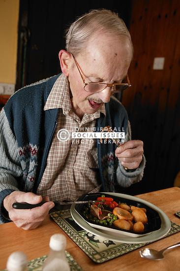 Elderly man having dinner; homecare for the elderly,