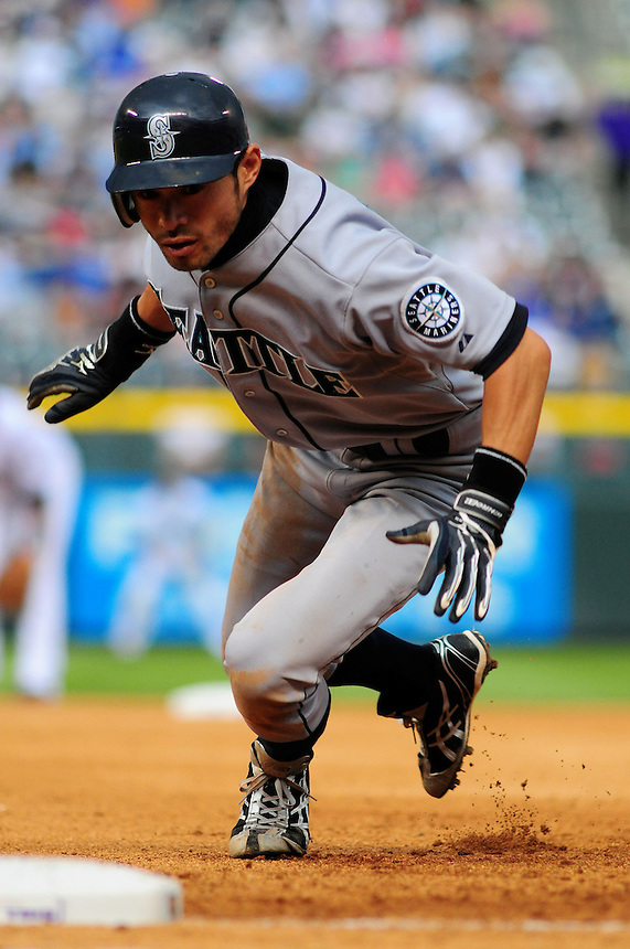 June 14, 2009: Mariners outfielder Ichiro Suzuki dives to 1st base to avoid a pickoff during a game between the Seattle Mariners and the Colorado Rockies at Coors Field in Denver, Colorado. The Rockies beat the Mariners 7-1 to tie a club record with 11 straight wins.