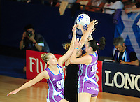 New Zealand's Catherine Latu gets hold of the ball under pressure from Scotland's Rachel Forbes, left, and Scotland's Hayley Mulheron<br /> <br /> Scotland Vs New Zealand - preliminary round - group A<br /> <br /> Photographer Chris Vaughan/CameraSport<br /> <br /> 20th Commonwealth Games - Day 3 - Saturday 26th July 2014 - Netball - SECC - Glasgow - UK<br /> <br /> © CameraSport - 43 Linden Ave. Countesthorpe. Leicester. England. LE8 5PG - Tel: +44 (0) 116 277 4147 - admin@camerasport.com - www.camerasport.com