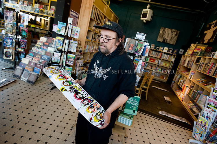 5/15/2008--Seattle, WA, USA<br /> <br /> Larry Reid, curator at Fantagraphics Bookstore and Gallery in Georgetown in Seattle, sometimes called the 'Last Outpost of Blue-Collar, Bohemian Arts Culture' in the city. Before being annexed by Seattle in 1910, Georgetown was a wide open saloon town with its own horse racing track, leading a local preacher to dub it &quot;the cesspool of Seattle.&quot; Built up by Boeing workers and the former Rainier Brewery, the neighborhood three miles south of the city faltered in the post-war era. <br /> <br /> &copy;Stuart Isett. All rights reserved.