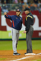 Auburn Tigers head coach John Pawlowski #8 argues a call with first base umpire Steve Dew during the game against the Alabama Crimson Tide at Riverwalk Park on March 15, 2011 in Montgomery, Alabama.  Photo by Brian Westerholt / Four Seam Images