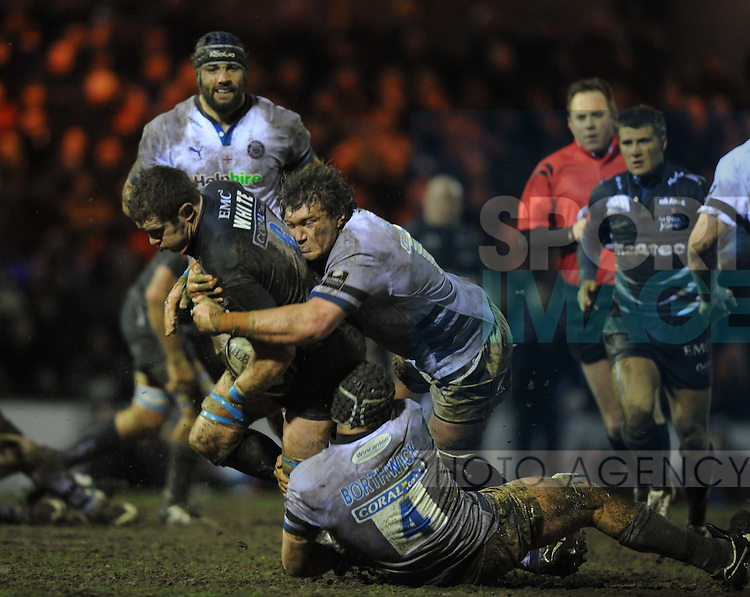 Jason White of Sale Sharks tackled by Bath's Peter Short and Steve Borthwick
