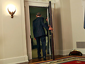 United States President Barack Obama departs after making a statement on the Paris Climate Agreement in the Cabinet Room of the White House in Washington, DC on December 12, 2015.<br /> Credit: Dennis Brack / Pool via CNP