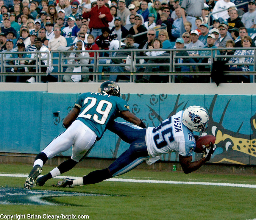 Tennessee Titans receiver Derrick Mason  (#85) catches a touchdown pass in front of Jacksonville Jaguar  defensive back Jason Craft during a game against the Jacksonville Jaguars in Jacksonville, FL on Sunday, December 22, 2002.  Tennessee won the game 28 to 10.  (Photo by Brian Cleary/www.bcpix.com)