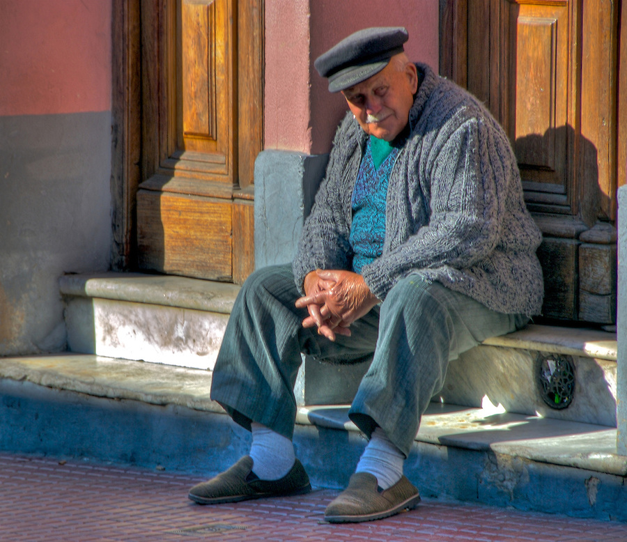 Old Man in San Telmo, seating outside early morning.