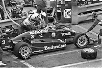 WEST ALLIS, WI - JUNE 2: Bobby Rahal makes a pit stop in his Budweiser March 85C/Cosworth during the Miller American 200 CART IndyCar race at the Milwaukee Mile in West Allis, Wisconsin, on June 2, 1985.