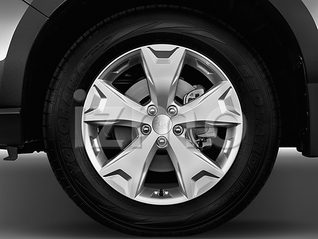 Tire and wheel close up detail view of a 2014 Subaru Forester 2.5i Premium2014 Subaru Forester 2.5i Premium