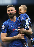 Chelsea's Olivier Giroud smiles at the home fans as he walks around the pitch with members of his family after the final whistle during Chelsea vs Watford, Premier League Football at Stamford Bridge on 5th May 2019