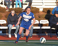 Boston Breakers midfielder Heather O'Reilly (9) at midfield looks to pass. In a National Women's Soccer League Elite (NWSL) match, the Boston Breakers (blue) tied the Washington Spirit (white), 1-1, at Dilboy Stadium on April 14, 2012.