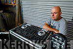 Local DJ Ray Stack at home in Ballyheigue, standing with his equipment that hasn't been in use since March due to the Covid 19 pandemic.