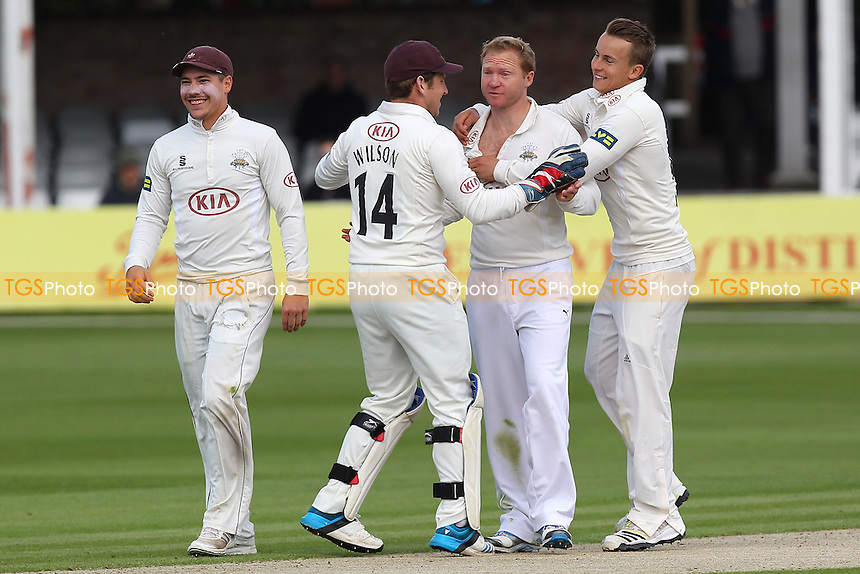 Gareth Batty of Surrey (2nd R) is congratulated on the wicket of Jaik Mickleburgh - Essex CCC vs Surrey CCC - LV County Championship Division Two Cricket at the Essex County Ground, Chelmsford, Essex - 25/05/14 - MANDATORY CREDIT: Gavin Ellis/TGSPHOTO - Self billing applies where appropriate - 0845 094 6026 - contact@tgsphoto.co.uk - NO UNPAID USE