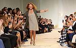 Designer Diane Von Furstenberg recieves applause after her presentation at New York Fashion Week in New York, Sunday, September 13, 2015. AFP PHOTO/TREVOR COLLENS