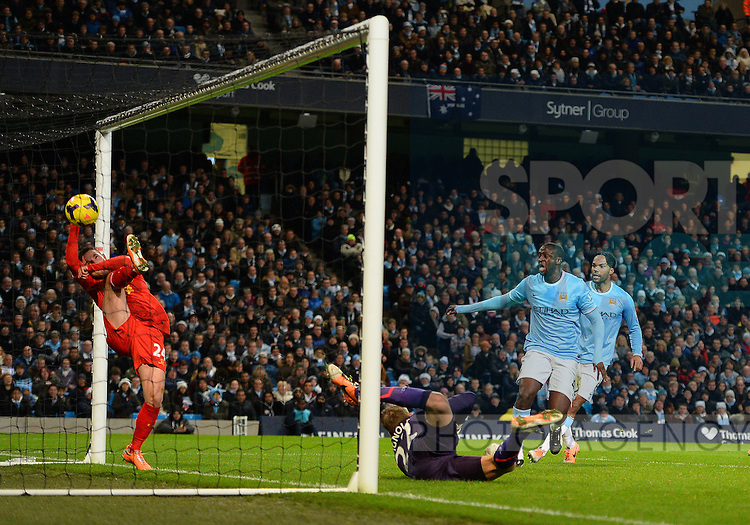 Yaya Toure of Manchester City looks on as Joe Allen of Liverpool tries to keep out a header from Vincent Kompany of Manchester City to equalise  - Barclays Premier League - Manchester City vs Liverpool - Etihad Stadium - Manchester - England - 26th December 2013  - Picture Simon Bellis/Sportimage