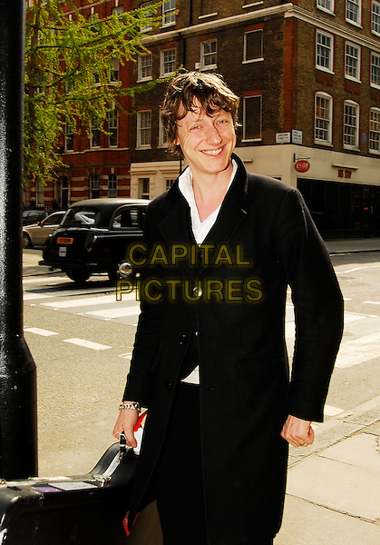 DOUGIE PAYNE - TRAVIS.Leaving the Jonathan Ross Show, London, England. .April 21st, 2007.half length black coat guitar band.CAP/IA.©Ian Allis/Capital Pictures