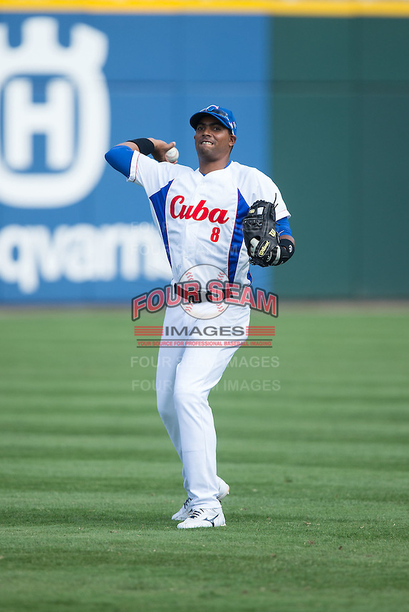 Raul Gonzalez Isidoria (8) of the Cuban National Team warms up prior to the game against the US Collegiate National Team at BB&T BallPark on July 4, 2015 in Charlotte, North Carolina.  The United State Collegiate National Team defeated the Cuban National Team 11-1.  (Brian Westerholt/Four Seam Images)