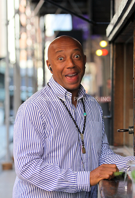 WWW.ACEPIXS.COM . . . . .  ....June 6 2011, New York City....Hip Hop mogul Russell Simmons grabs a cup of coffee from a street stand in Soho on June 6 2011 in New York City....Please byline: CURTIS MEANS - ACE PICTURES.... *** ***..Ace Pictures, Inc:  ..Philip Vaughan (212) 243-8787 or (646) 679 0430..e-mail: info@acepixs.com..web: http://www.acepixs.com