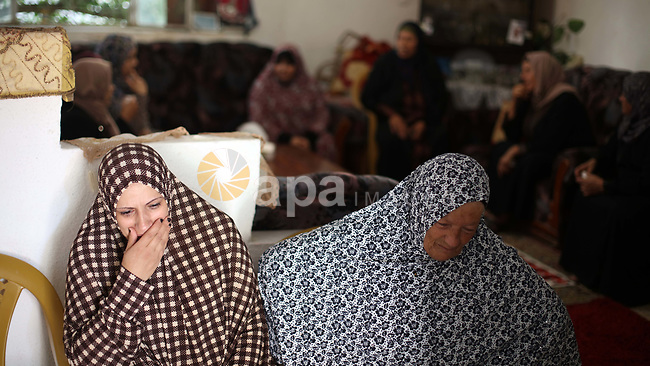 Relatives of a Palestinian Alaa al-Hraimi, who was killed by Israeli security forces following a car-ramming attack, mourn at their house in the West Bank city of Bethlehem, August 16, 2019. Two Israeli youths were wounded in a car-ramming attack near a West Bank bus stop on Friday, Israeli military saidjewish. Photo by Abedalrahman Hassan