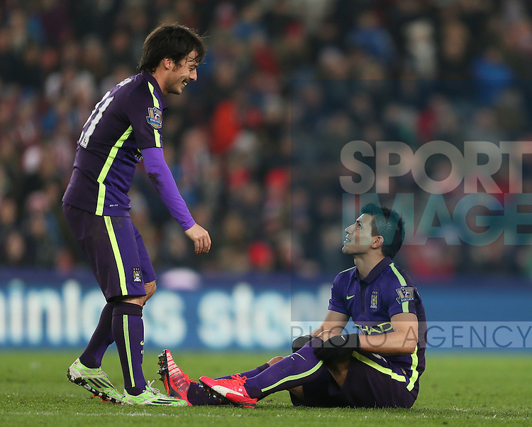 David Silva of Manchester City talks to Sergio Aguero of Manchester City sits injured waiting to leave the field - Barclays Premier League - Stoke City vs Manchester City - Britannia Stadium - Stoke on Trent - England - 11th February 2015 - Picture Simon Bellis/Sportimage