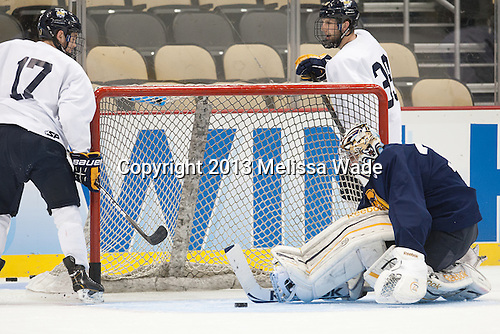 Jeremy Langlois (QU - 17), Eric Hartzell (QU - 33), Clay Harvey (QU - 39) - The Frozen Four competitors practice at Pittsburgh's Consol Energy Center on Wednesday, April 10, 2013, in preparation for their semi-final games on Thursday.