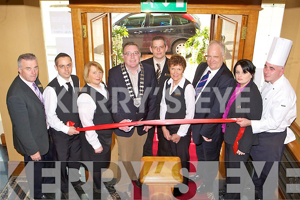 RE-OPENED: Kerry Mayor Bobby O'Connell cuts the tape to officially reopen the River Island Hotel, Castleisland, last Friday, pictured l-r: Tom McCarthy, John Begley, Geraldine Hickey, Mayor Bobby O'Connell, Billy O'Connor (general manager), Eileen Reidy, Giles Casey, Claire Hartnett and David O'Brien.