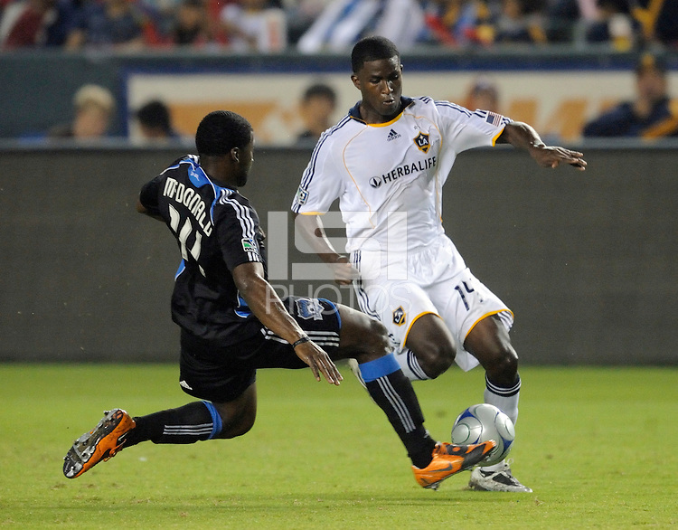 Los Angeles Galaxy's Edson Buddle gets past San Jose Earthquakes Brandon McDonald at the Home Depot Center. Los Angeles Galaxy beat San Jose 2-0 Saturday, October 24. 2009, in Carson, California. .