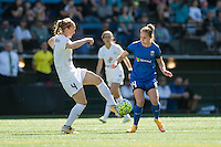 Seattle, WA - Sunday, May 1, 2016: FC Kansas City defender Becky Sauerbrunn (4) clears the ball from Seattle Reign FC forward Manon Melis (14) during the first half of the match at Memorial Stadium.