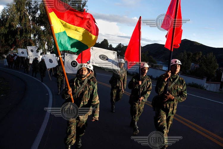 Bolivian Navy officers in training march to target practice at the Tiquina Naval Base on Lake Titicaca. Bolivia lost what is now northern Chile in a war over nitrates leaving Bolivia without access to the ocean.