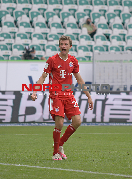 27.06.2020, Fussball: nph00001 1. Bundesliga 2019/2020, 34. Spieltag, VfL Wolfsburg - FC Bayern Muenchen, in der Volkswagen-Arena Wolfsburg. Jubel TorschŸtze Thomas MŸller (Bayern MŸnchen) zum Tor zum 0:4<br /><br />Foto: Bernd Feil/M.i.S./ /Pool/nordphoto<br /><br />Nur fŸr journalistische Zwecke! Only for editorial use! <br /><br />GemŠ§ den Vorgaben der DFL Deutsche Fussball: nph00001 Liga ist es untersagt, in dem Stadion und/oder vom Spiel angefertigte Fotoaufnahmen in Form von Sequenzbildern und/oder videoŠhnlichen Fotostrecken zu verwerten bzw. verwerten zu lassen. DFL regulations prohibit any use of photographs as image sequences and/or quasi-video.    <br /><br />National and international NewsAgencies OUT.