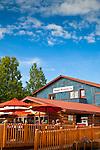 Tourists dining on the outdoor deck of Denali Brewing Company &<br /> Twister Creek Restaurant, Talkeetna, Southcentral Alaska, Summer.