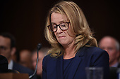 Christine Blasey Ford, the woman accusing Supreme Court nominee Brett Kavanaugh of sexually assaulting her at a party 36 years ago, testifies before the US Senate Judiciary Committee on Capitol Hill in Washington, DC, September 27, 2018.  / POOL / SAUL LOEB