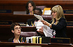 Nevada Assemblywoman Heidi Swank, D-Las Vegas, gets paperwork from Assistant Sgt.-at-Arms Vickie Kieffer during Assembly floor action in the final hours of the session at the Legislative Building in Carson City, Nev., on Monday, June 1, 2015. <br /> Photo by Cathleen Allison