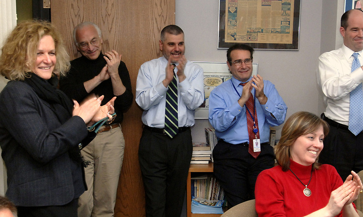 Coworkers gathered in the office of James M. Klurfeld, Editor of the Editorial Pages, at Newsday in Melville on Monday April 16, 2007, congratulate Newsday Cartoonist, Walter Handelsman for winning a Pulitzer for his Editorial Cartoons. Photo by/Jim Peppler.
