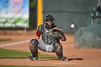 Kyle Pollock (51) of the Idaho Falls Chukars warms up the pitcher in the bullpen before the game against the Ogden Raptors in Pioneer League action at Lindquist Field on June 22, 2015 in Ogden, Utah.The Chukars defeated the Raptors 4-3 in 11 innings.  (Stephen Smith/Four Seam Images)