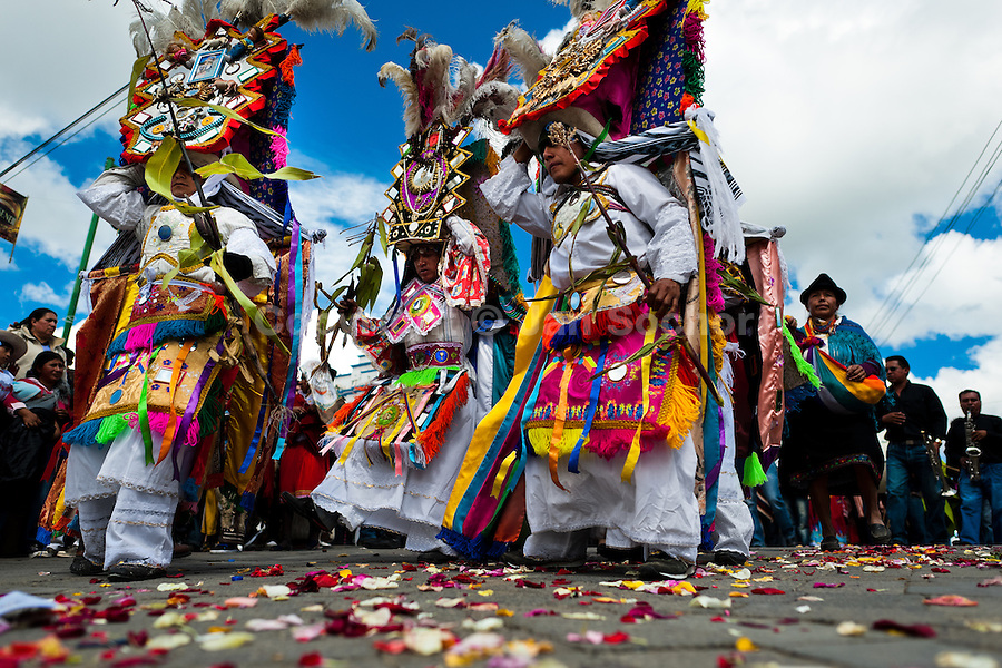 Dancers (danzantes) perform in the religious parade within the Corpus Christi festival in Pujilí, Ecuador, 1 June 2013. Every year in June, thousands of people gather in a small town of Pujili, high in the Andes, to celebrate the Catholic feast of Corpus Christi. Introduced originally during the Spanish conquest of South America, this celebration merges Catholic rituals of Holy Communion with the traditional Andean harvest and sun festivities (Inti, the Inca sun god). Women dancers perform wearing brightly colored costumes while men dancers wear chest ornaments and heavy elaborate headdresses adorned with mirrors, jewelry, or natural items (shells). Being a dancer in the Corpus Christi ceremonial parade (El Danzante) is considered an honour and a privilege by the indigenous people in Ecuador.