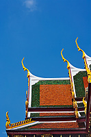 Gilded rooftop architecture of the Royal Pantheon or Prasat Phra Thep Bidon, Wat Phra Kaeo, Bangkok, Thailand