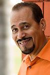 Mature hispanic man smiling