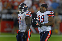 Oct. 16, 2006; Glendale, AZ, USA; Chicago Bears defensive tackle (91) Tommie Harris and nose tackle (99) Tank Johnson against the Arizona Cardinals at University of Phoenix Stadium in Glendale, AZ. Mandatory Credit: Mark J. Rebilas