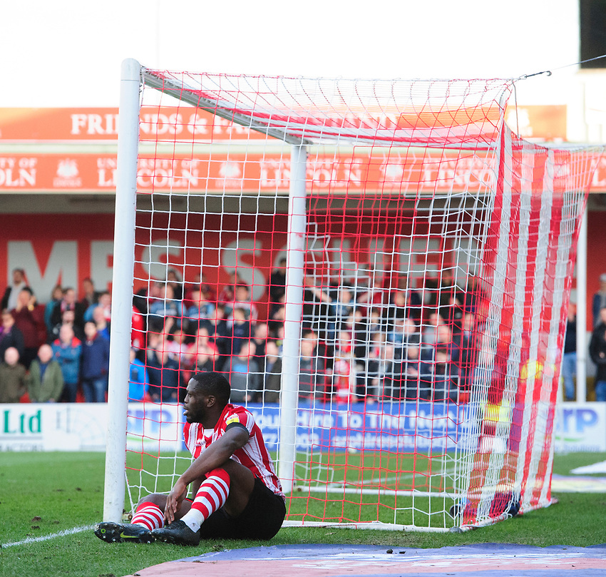 Lincoln City's John Akinde reacts after his appeal for a penalty was turned down<br /> <br /> Photographer Chris Vaughan/CameraSport<br /> <br /> The EFL Sky Bet League Two - Lincoln City v Stevenage - Saturday 16th February 2019 - Sincil Bank - Lincoln<br /> <br /> World Copyright © 2019 CameraSport. All rights reserved. 43 Linden Ave. Countesthorpe. Leicester. England. LE8 5PG - Tel: +44 (0) 116 277 4147 - admin@camerasport.com - www.camerasport.com