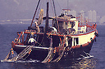 CHINESE FISHING BOAT IN HONG KONG HARBOR