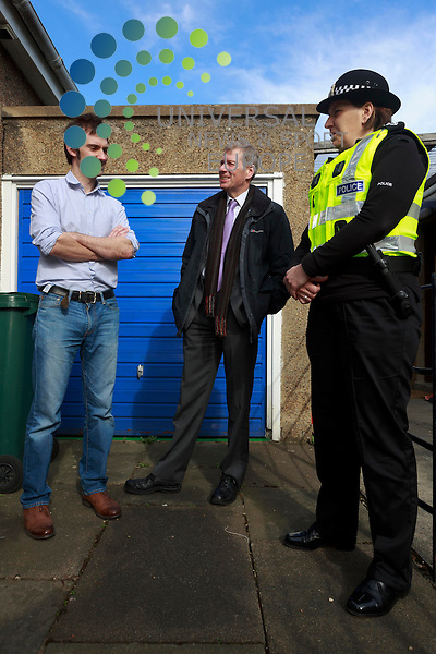 Simon who had his bike stolen outside of his house with Justice Secretary Kenny MacAskill and a member of the police.<br /> The Justice Secretary was learning of a successful police initiative to beat thieves. Mr  MacAskill met members of dedicated police team from  Edinburgh Division set up to tackle the capital's housebreakers. Photos taken in Davidson Road. Edinburgh. <br /> Pic: Pako Mera/Universal News And Sport (Europe) 26/03/2014