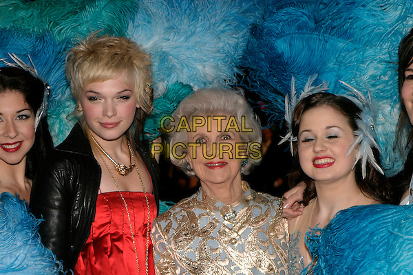 "ANNA BREWSTER & DORRIS BARRY.""Mrs. Henderson Presents"" - UK film premiere at Vue West End, London, UK..November 23rd, 2005.Ref: AH.headshot portrait blue feathers .www.capitalpictures.com.sales@capitalpictures.com.© Capital Pictures."