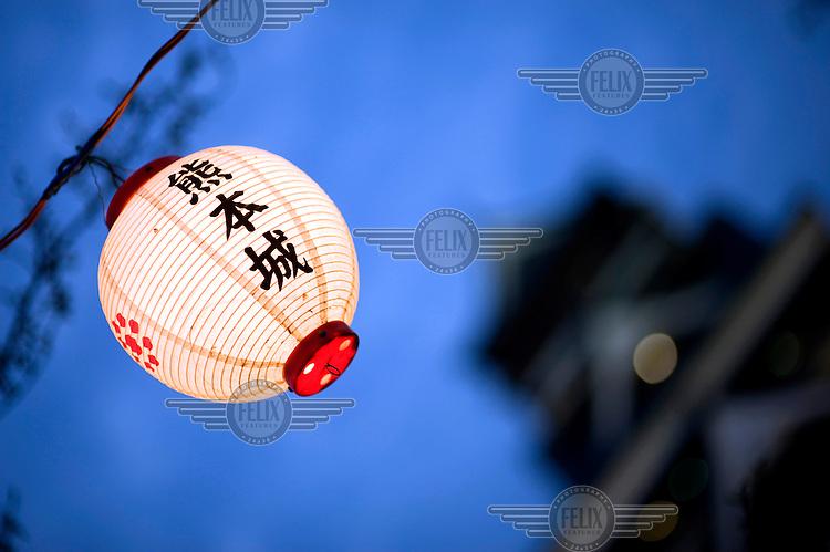A paper lantern glows outside Kumamoto Castle (Kumamoto-jo). /Felix Features