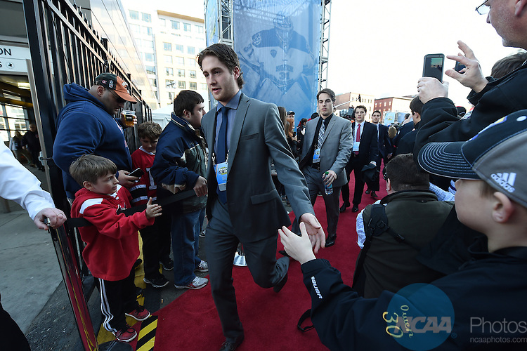 11 APR 2015: Players arrive on the red carpet during the Division I Men's Ice Hockey Championship held at the TD Garden in Boston, MA. Brian Babineau/NCAA Photos